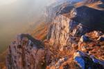 Ридът Кобилини стени огряв от мека залезна светлина.